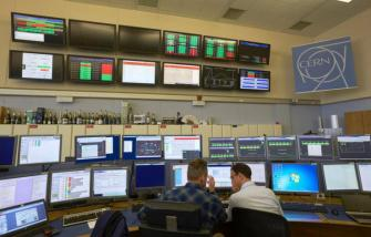 Technicians work in the Control Centre of the Large Hadron Collider (LHC) at the European Organisation for Nuclear Research (CERN) in Prevessin, France, near Geneva in Switzerland March 11, 2015. REUTERS/Denis Balibouse