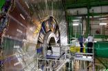 Technicians work in the Compact Muon Solenoid (CMS) experiment, part of the Large Hadron Collider (LHC), during a media visit to the Organization for Nuclear Research (CERN) in Cessy, France, near Geneva in Switzerland, July 23, 2014. REUTERS/Pierre Albouy