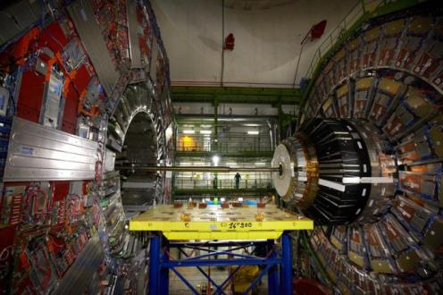 A technician stands near equipment of the Compact Muon Solenoid (CMS) experience at the Organization for Nuclear Research (CERN) in the French village of Cessy, France, near Geneva in Switzerland April 15, 2013. REUTERS/Denis Balibouse