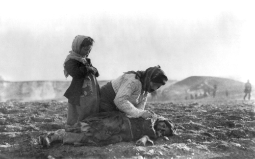 Armenian_woman_kneeling_beside_dead_child_in_field.png